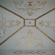Gold ornamental design on blue venetian plaster
