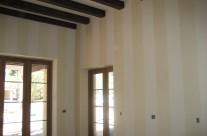 Gold wax stripes on master bedroom walls