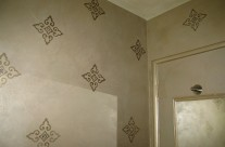 Shimmery plaster with medallion stencil